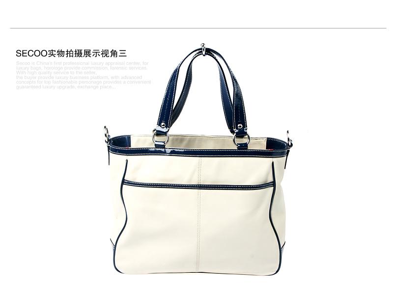 女士乳白色手提包